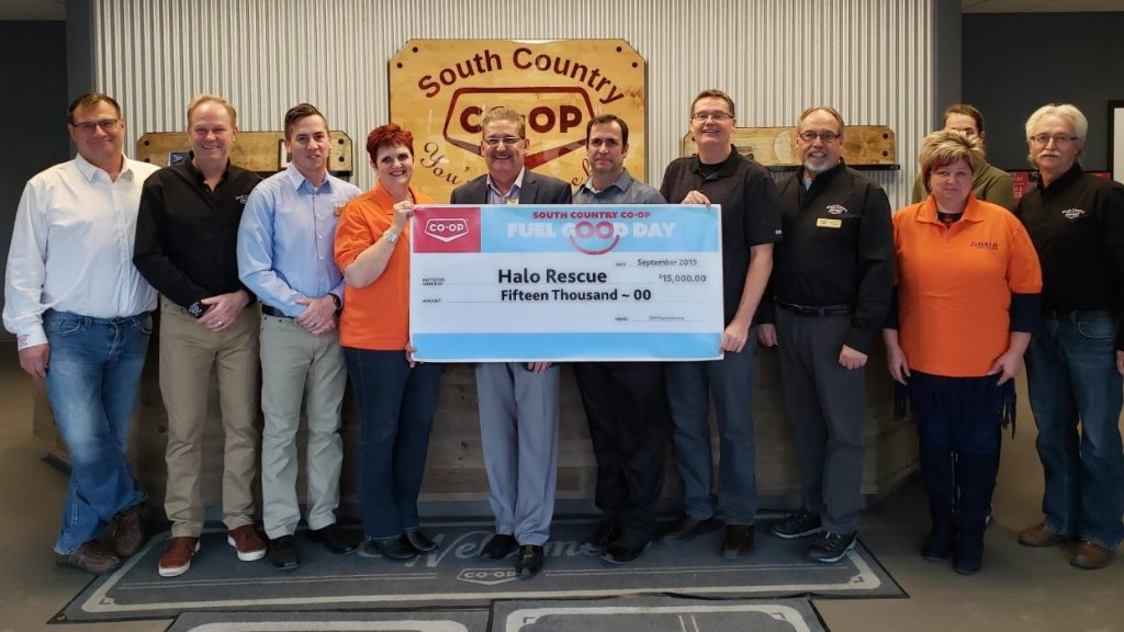 South Country Co-op presents cheque to HALO